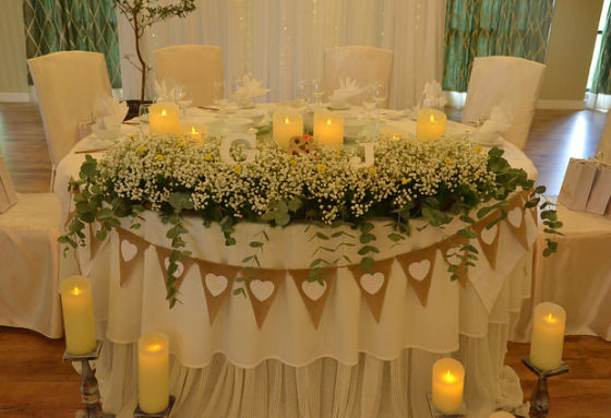 a table with white decoration